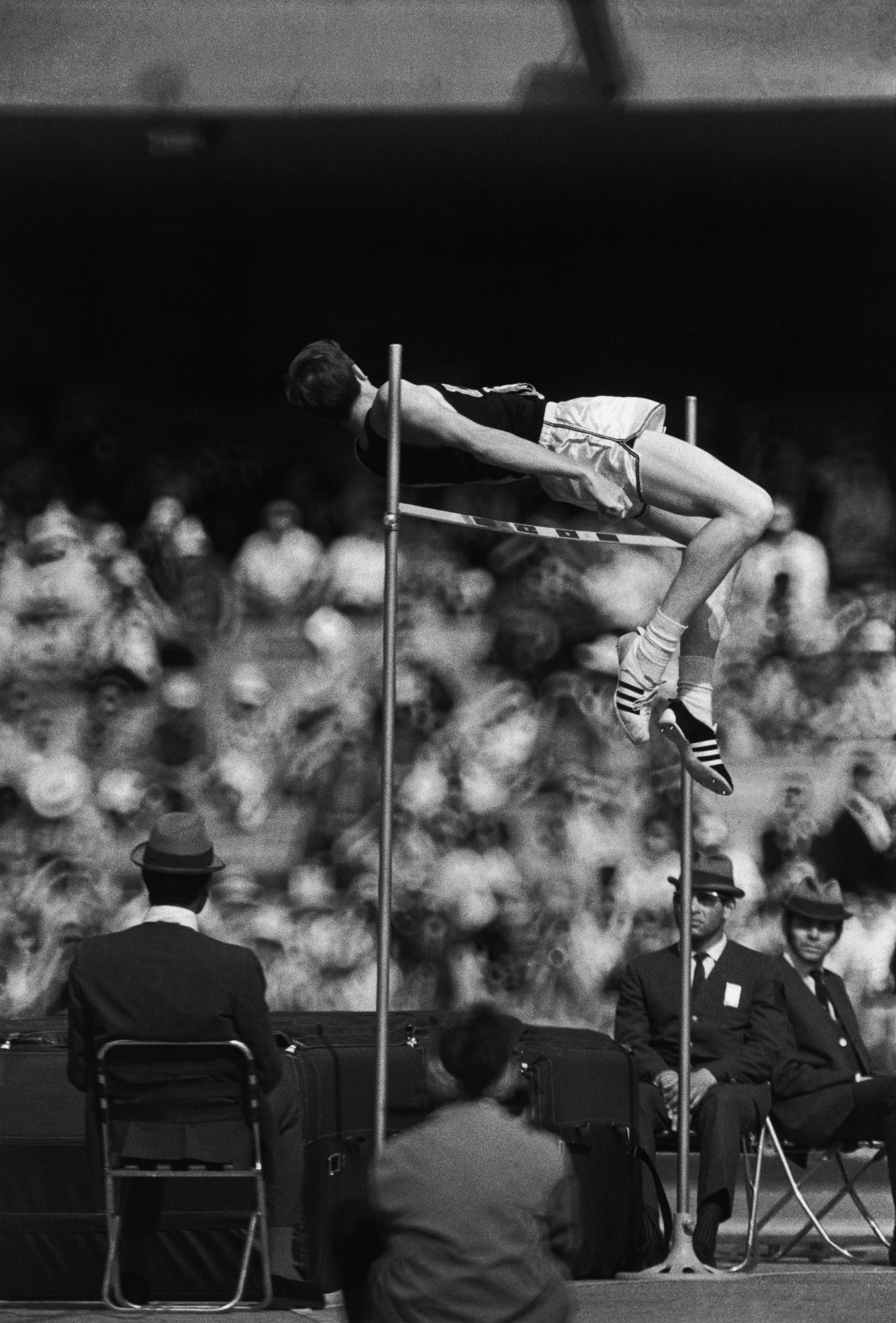 "MEXICO. Mexico city. Olympic games. High jump competition. The american athlete Dick FOSBURY invente the ""Fosbury flop"" and reach Valeri BRUMEL's record. 1968."